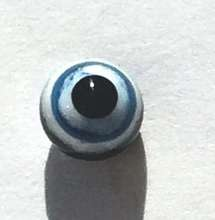 Black with blue and white ring around pupil. 4 mm