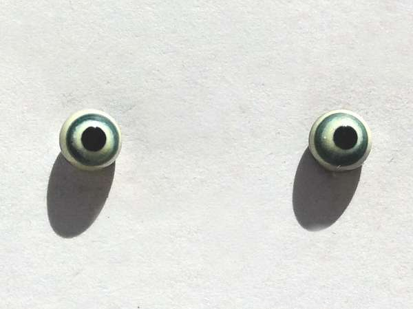 Black with blue and light yellow ring around pupil. 4 mm