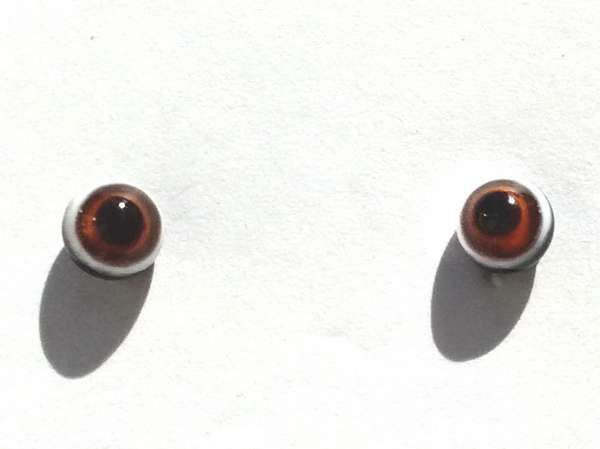 Black with orange and white ring around pupil. 4 mm