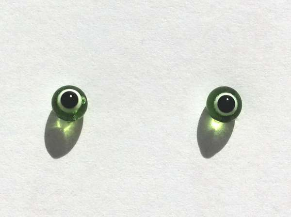 Green with white ring around pupil. 4 mm