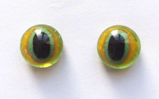 Brown green, vertical pupil. 12 mm