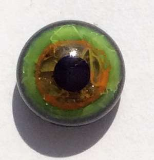 Green and yellow on black, crackle. 7 mm