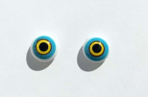 Sky blue with yellow rim. 9 mm